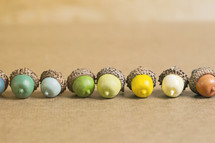 row of colorful acorns