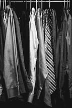 Men's shirts hanging in a closet.