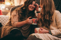 friends in conversation over hot cocoa