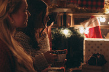 women in conversation while drinking hot cocoa