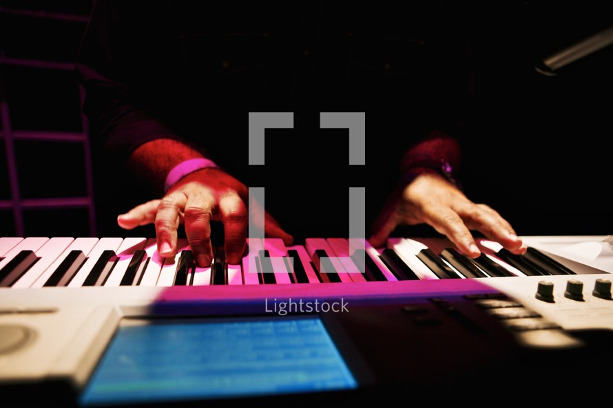 Male hands playing keyboard