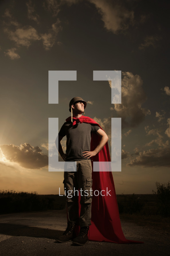 Man wearing a red cape and helmet