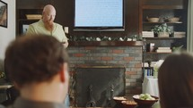 man leading a Bible study in a living room