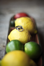 wedding bands on lemons and limes
