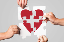 four pieces of a puzzle to make a heart