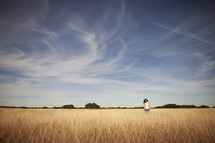 Woman on dry wheat field