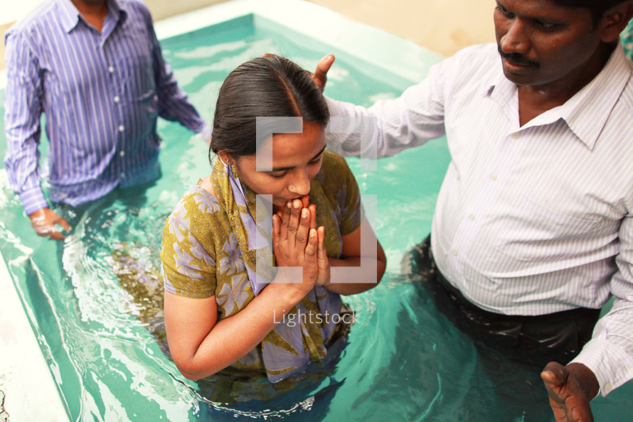 Man baptizing woman