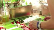 a woman making sushi