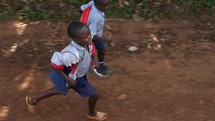 kids running along side a vehicle