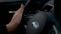 a woman's hands on a steering wheel