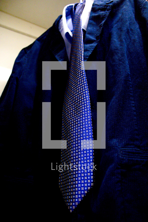 tie and suit on a hanger