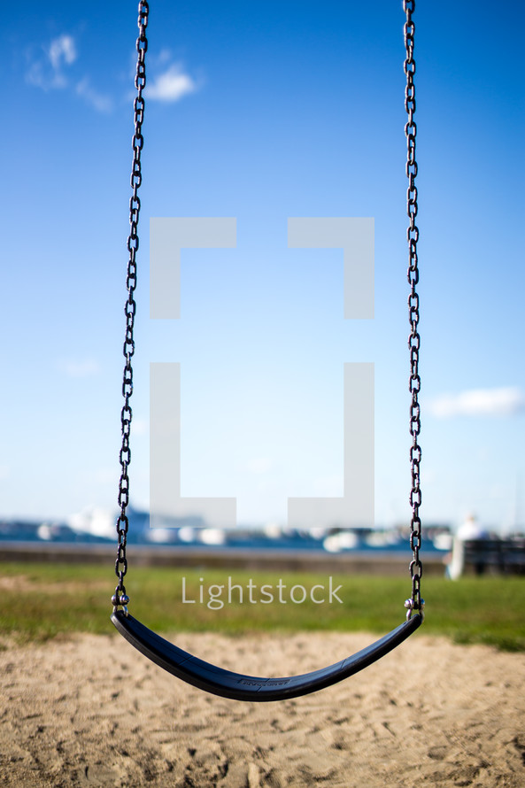 Swing with chains ropes.