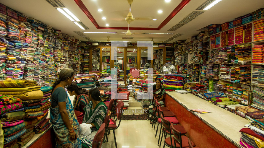 women in a fabric store
