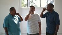 a group of men receiving communion