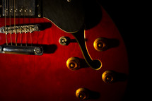 saddle and knobs on an electric guitar