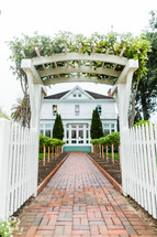 Pathway leading to house brick walkway white victorian home picket fence
