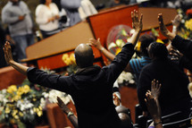 hands raised in worship to God at Church
