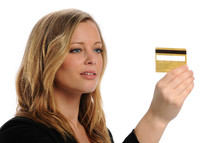 woman looking a credit card