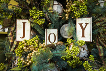 word Joy in a Christmas tree