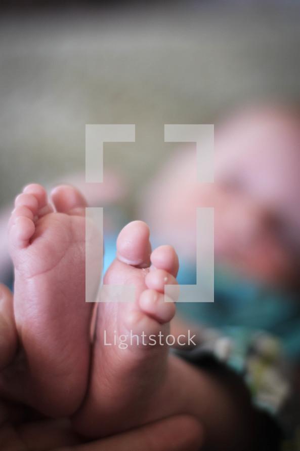 newborn baby boy feet photo by angela lightstock
