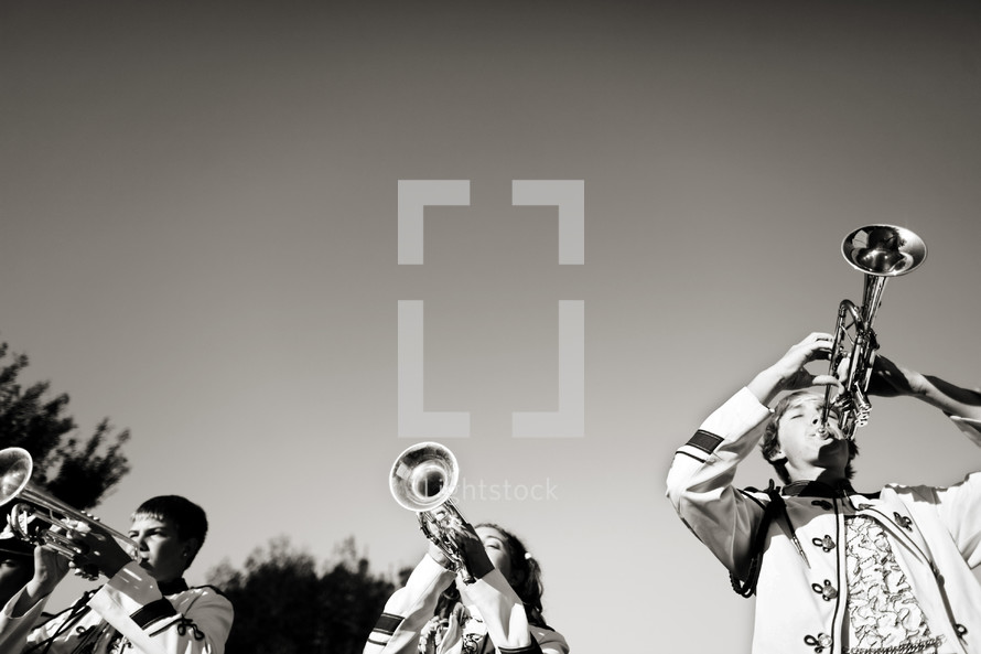 School bandmates playing trumpet marching band high school music brass