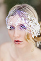 white lace over the eyes of a woman bride, bridal veil