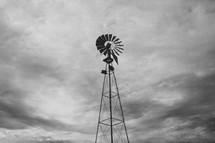 windmill in a cloudy sky