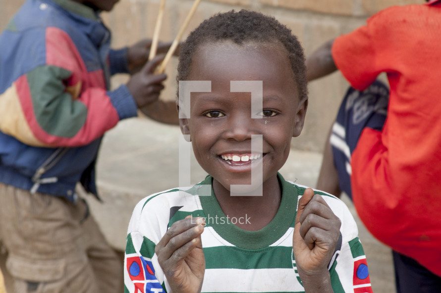 clapping boy child with smile on his face