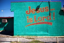 """Jesus Is Lord"" written on building wall"