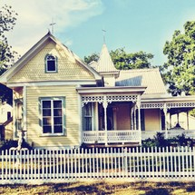 Yellow house and white picket fence