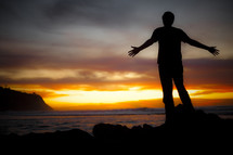 Man standing on beach watching sunset - God is my salvation