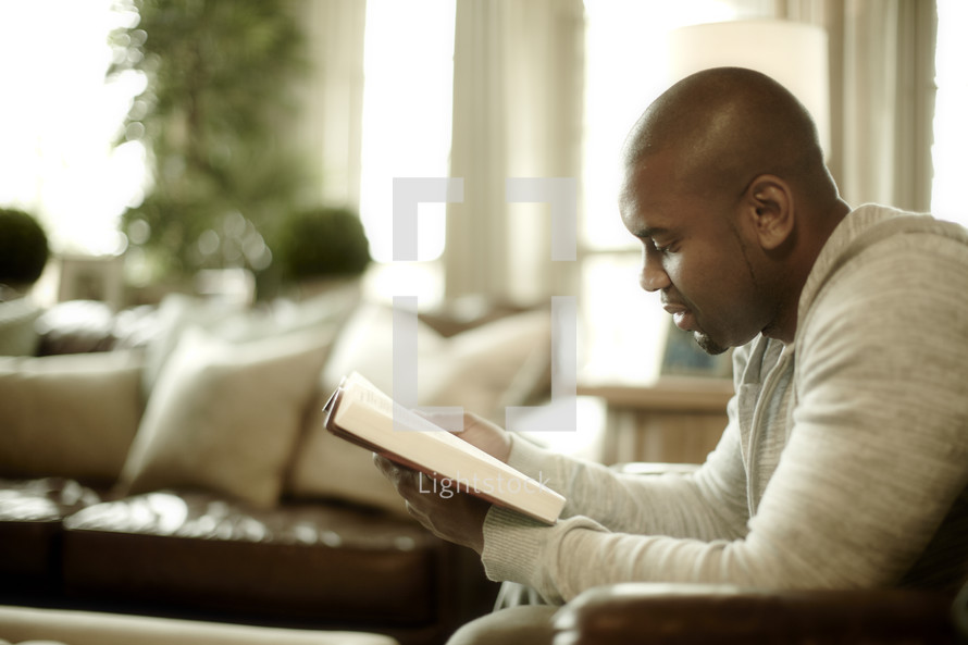 An African American man reads the Bible