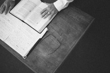Man looking over Bible and Bible notes