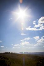 sunburst over hills