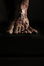 Blood flows down Jesus' nail scarred feet
