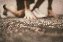 hands and feet of a runner