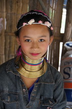 A young hill tribe girl wearing brass rings around her neck