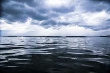 Ocean waves under a stormy sky.