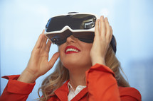 a woman wearing VR glasses