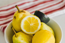 pears and lemons in a bowl