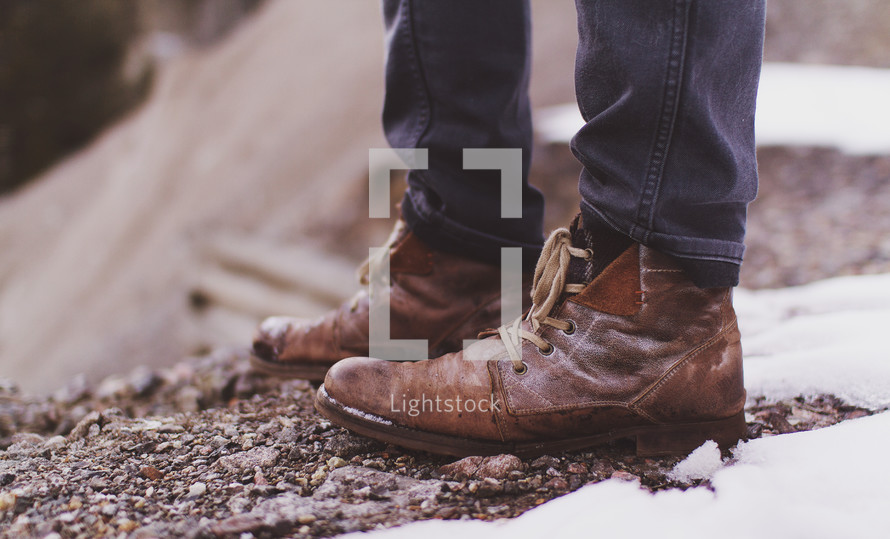 brown boots and snow