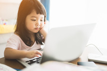 a toddler on a laptop computer