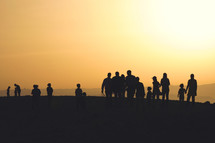 silhouettes of people on a mountaintop