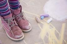 child and sidewalk chalk