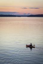kayaking on a lake at sunset