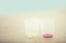 pills in cups