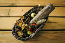 a fall centerpiece, logs in a basket