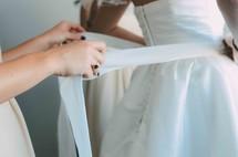tying a brides dress
