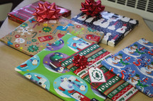 wrapped Christmas gifts on a school table