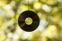 CD hanging on a string